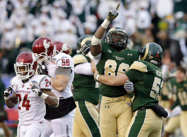 Colorado State's Kivon Cartwright (86) and Tanner Hedstrom (53) celebrate their win as Washington State Cougars running back Theron West (24) and Joe Dahl (56) leave the field after the NCAA New Mexico Bowl college football game, Saturday, Dec. 21, 2013, in Albuquerque, N.M. Colorado State won 48-45.(AP Photo/Matt York)