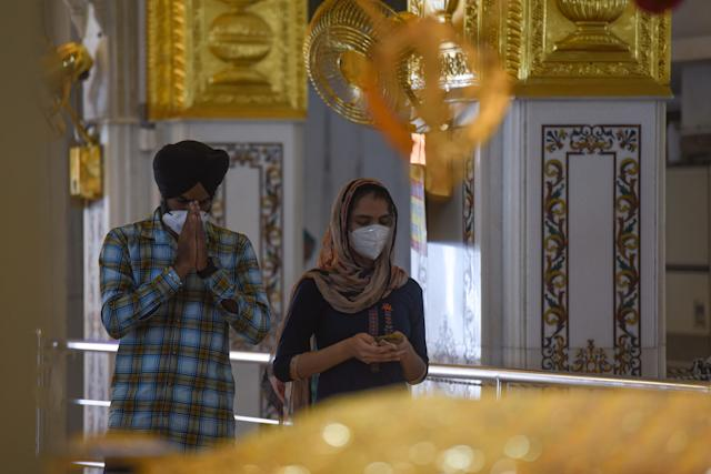 NEW DELHI, INDIA - JUNE 8: Devotees offer prayers inside Gurudwara Bangla Sahib after it reopened to the public for the first time since the nationwide lockdown was imposed to curb the spread of coronavirus, near Connaught Place, on June 8, 2020 in New Delhi, India. (Photo by Sanchit Khanna/Hindustan Times via Getty Images)