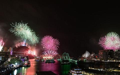 <span>Fireworks explode over Sydney Harbour as part of New Year's Eve celebrations</span> <span>Credit: Rex </span>