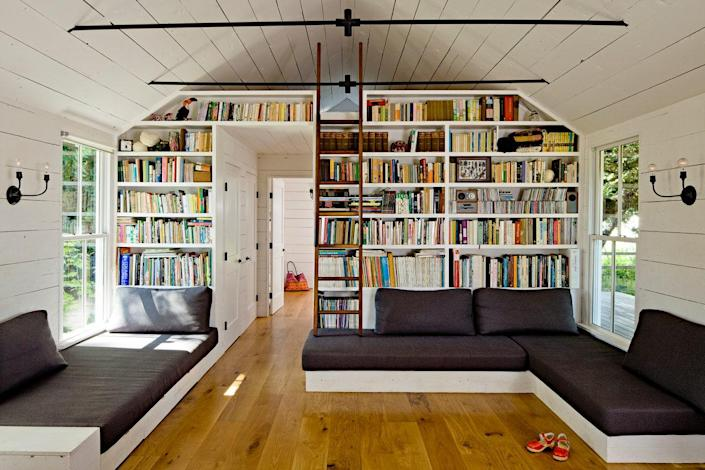 The other side of the great room comprises the living room and a ladder to the loft. That space features bookcases designed and built by Doulis with the help of an architect friend.