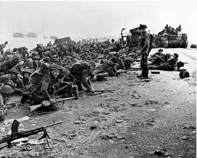 <p>After landing at the shore, these British troops wait for the signal to move forward during the initial Allied landing operations in Normandy, France, on June 6, 1944. (Photo: AP) </p>