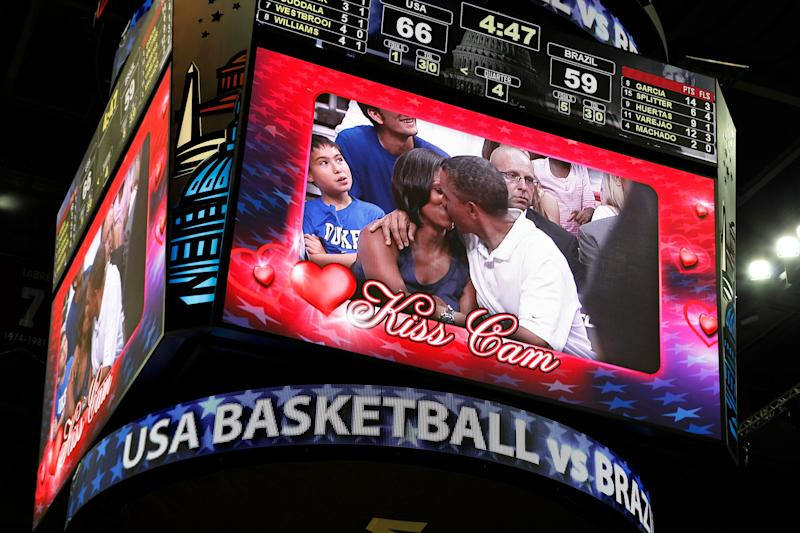 President Barack Obama and first lady Michelle Obama are shown kissing on the kiss cam screen during a timeout in the Olympic basketball exhibition game between the U.S. and Brazil national men's teams in Washington on July 16, 2012.