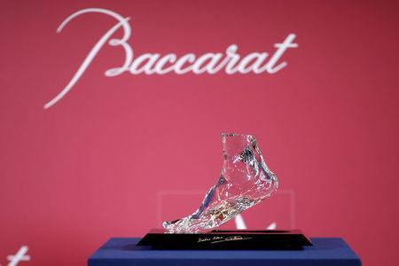 """The """"Zidane's Crystal Foot"""" created by Baccarat is displayed during a presentation for a charity art auction for the benefit of European Leukodystrophy Association (ELA) in Paris, June 12, 2018. REUTERS/Benoit Tessier"""