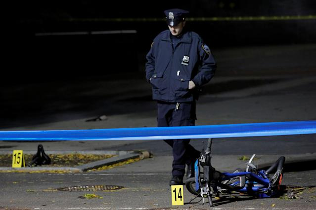 <p>A police officer investigates crushed bicycles on a bicycle lane the day after a pickup truck attack on the West Side Highway in Manhattan, New York, Nov. 1, 2017. (Photo: Andrew Kelly/Reuters) </p>