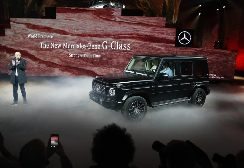 Daimler AG Chairman Dr. Dieter Zetsche applauds during the world premiere of the Mercedes-Benz G-Class during a preview day before the North American International Auto Show, Sunday, Jan. 14, 2018, in Detroit. (AP Photo/Carlos Osorio)