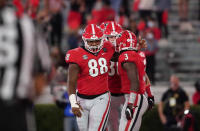 Georgia defensive lineman Jalen Carter (88) celebrates with running back Zamir White (3) after White scored a touchdown during the first half of the team's NCAA college football game against Auburn on Saturday, Oct. 3, 2020, in Athens, Ga. (AP Photo/Brynn Anderson)