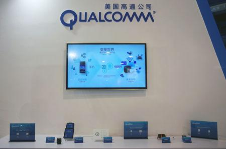 A booth of U.S. chipmaker Qualcomm is pictured at an expo in Beijing, China, September 27, 2017. Picture taken September 27, 2017. REUTERS/Stringer