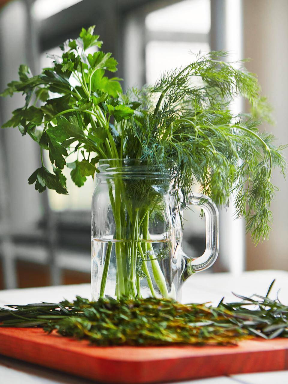 Treat your fresh herbs like a bouquet of flowers, and change the water frequently (Getty/iStock)