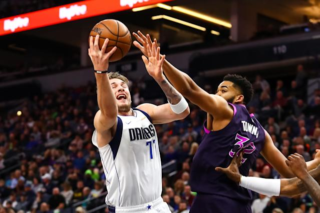 MINNEAPOLIS, MN - JANUARY 11: Karl-Anthony Towns #32 of the Minnesota Timberwolves reaches to block a shot by Luka Doncic #77 of the Dallas Mavericks in the first quarter at Target Center on January 11, 2019 in Minneapolis, Minnesota. (Photo by David Berding/Getty Images)