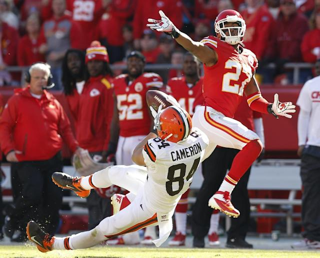 Cleveland Browns tight end Jordan Cameron (84) catches the ball while covered by Kansas City Chiefs cornerback Sean Smith (27) during the second half of an NFL football game in Kansas City, Mo., Sunday, Oct. 27, 2013. (AP Photo/Ed Zurga)