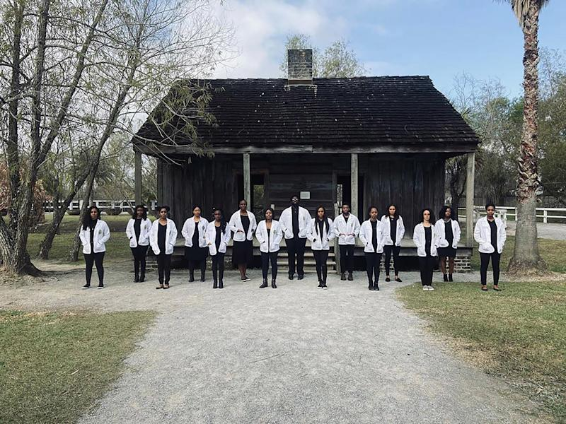 Powerful Photo Shows Black Medical Students Standing on Former Slave Plantation in White Coats