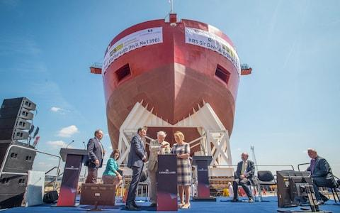 Sir David Attenborough presses the launch button for the RSS Sir David Attenborough, which the public voted to name Boaty McBoatface - Credit: Mercury Press & Media
