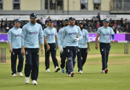 England players walk off the field at the end of Sri Lankan innings during the third one day international cricket match between England and Sri Lanka, at Bristol County Ground in Bristol, England, Sunday, July 4, 2021. (AP Photo/Rui Vieira)