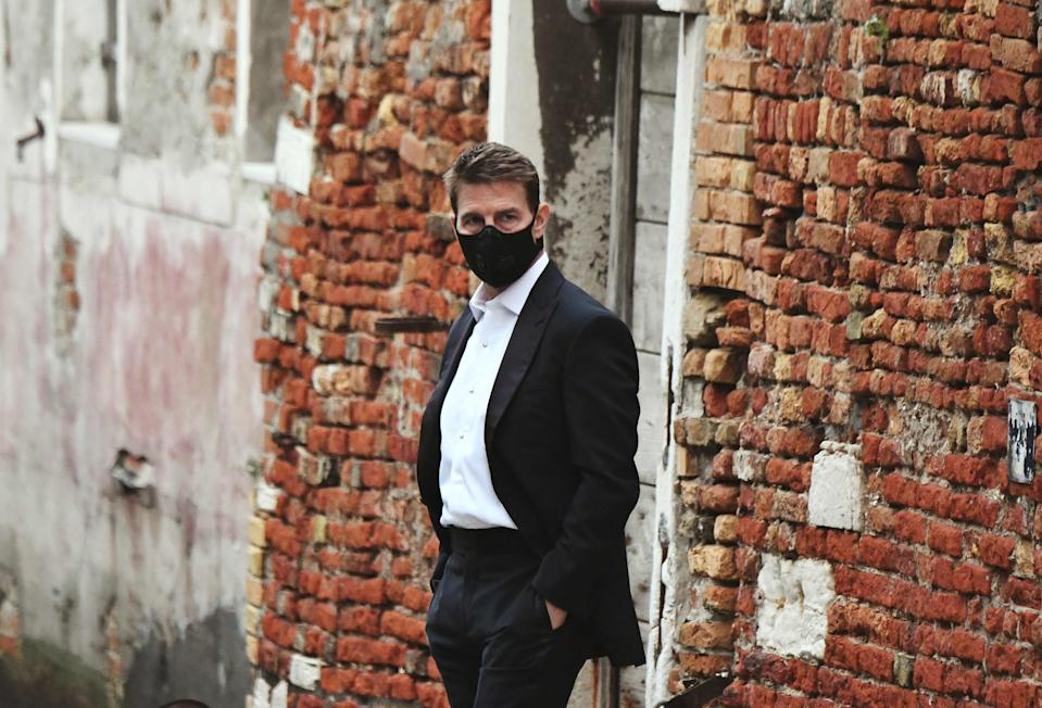 """Tom Cruise wears a mask on the set of """"Mission: Impossible 7"""" in Venice."""