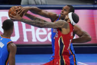 New Orleans Pelicans forward Brandon Ingram, front right, drives past Oklahoma City Thunder's Al Horford, rear right, in the first half of an NBA basketball game Thursday, Dec. 31, 2020, in Oklahoma City. (AP Photo/Sue Ogrocki)