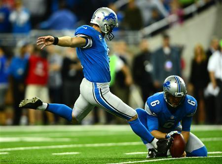 Detroit Lions kicker David Akers (2) kicks the game winning extra point during the fourth quarter to defeat the Dallas Cowboys 31-30 at Ford Field. Mandatory Credit: Andrew Weber-USA TODAY Sports
