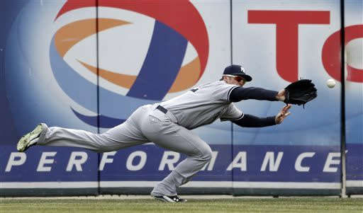 New York Yankees right fielder Brennan Boesch dives but misplays a double by Detroit Tigers' Miguel Cabrera during the third inning of a baseball game in Detroit, Saturday, April 6, 2013. (AP Photo/Carlos Osorio)