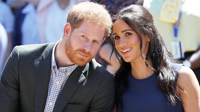 Harry and Meghan Harry looks concerned Meghan is smiling but looks confused