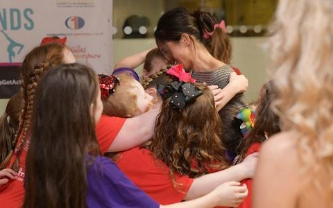 Meghan Markle hugs children from a street dance class in Cardiff - Credit: Geoff Pugh