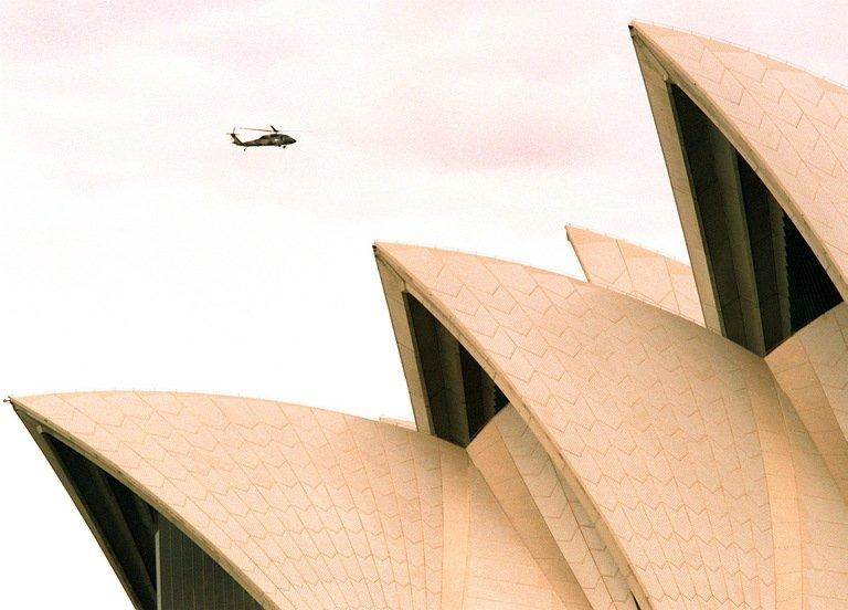 A helicopter is seen flying over the Sydney Opera House, on August 11, 1998