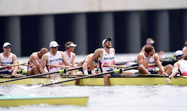 GB's men's eight team after crossing the line