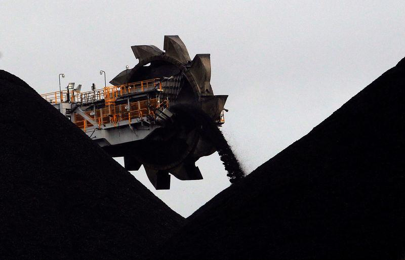 FILE PHOTO: A reclaimer places coal in stockpiles at the coal port in Newcastle