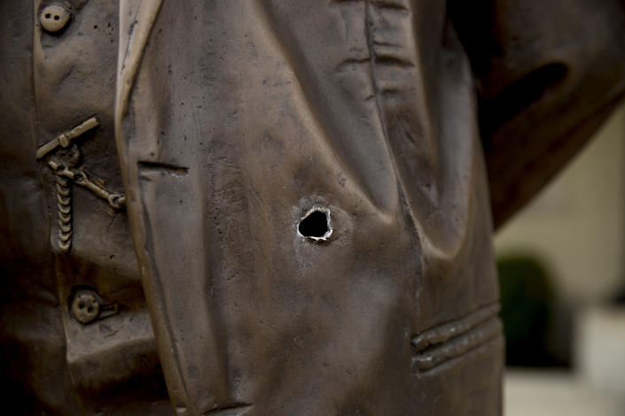 A bullet hole is visible in the statue of Cuban independence hero José Martí outside the Cuban Embassy in Washington, Friday, May 1, 2020, after a man opened fire with an assault rifle on Thursday morning. Officers found the suspect with an assault rifle and took the person into custody without incident, police said. (AP Photo/Andrew Harnik)