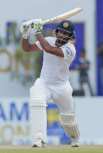 Sri Lanka's Dimuth Karunaratne plays a shot during the fourth day of the first test cricket match between Sri Lanka and New Zealand in Galle, Sri Lanka, Saturday, Aug. 17, 2019. (AP Photo/Eranga Jayawardena)