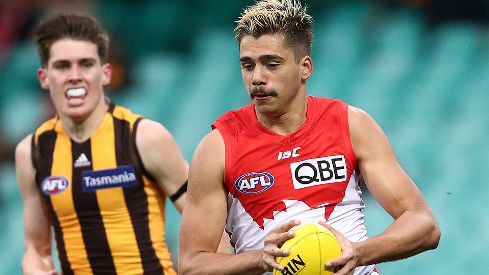 Elijah Taylor can be seen here in action for Sydney against Hawthorn in the AFL.