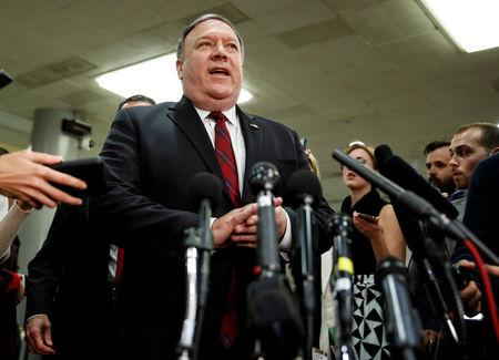 FILE PHOTO: U.S. Secretary of State Mike Pompeo speaks to the media after a closed briefing for senators about the latest developments related to the death of Saudi journalist Jamal Khashoggi on Capitol Hill in Washington, U.S., November 28, 2018.      REUTERS/Joshua Roberts/File Photo
