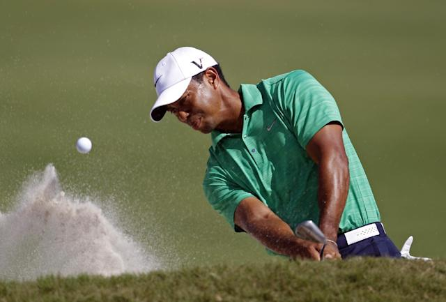 Tiger Woods blasts out of a bunker on the 10th hole during the third round of the Cadillac Championship golf tournament on Saturday, March 10, 2012 in Doral, Fla. (AP Photo/Lynne Sladky)