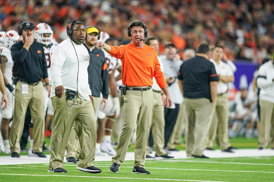 HOUSTON, TX - DECEMBER 27: Oklahoma State Cowboys head coach Mike Gundy looks on during the football game between the Oklahoma State Cowboys and Texas A&M Aggies on December 27, 2019 at NRG Stadium in Houston, TX.  (Photo by Daniel Dunn/Icon Sportswire via Getty Images)