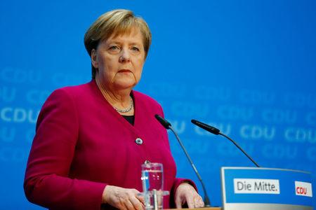 German Chancellor Angela Merkel attends a news conference following the Hesse state election in Berlin