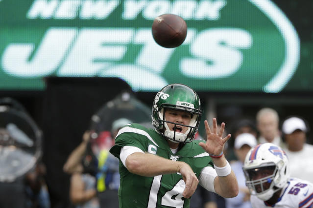 FILE - In this Sept. 8, 2019, file photo, New York Jets quarterback Sam Darnold (14) throws a pass during the second half of an NFL football game against the Buffalo Bills, in East Rutherford, N.J. Darnold has been cleared by doctors to play this week after he missed three games while recovering from mononucleosis. The Jets announced in a Twitter post that Darnold will start Sunday at home against Dallas. (AP Photo/Seth Wenig, File)