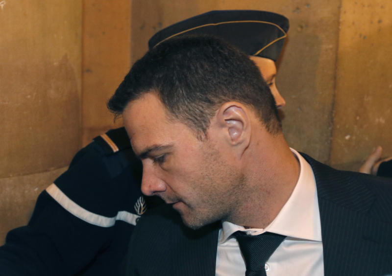 Former trader Jerome Kerviel arrives at court, in Paris, Wednesday Oct. 24, 2012. The Paris appeals court on Wednesday ordered former Societe Generale trader Jerome Kerviel to spend three years in prison and pay back a staggering euro 4.9 billion (about $7 billion) in damages for one of the biggest trading frauds in history. (AP Photo/Francois Mori)
