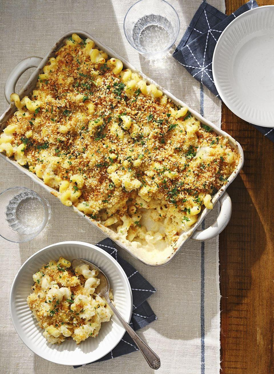 "<p>Baked mac is the elegant version of the weeknight stovetop variety. Don't skip the cauliflower, it gives this dish an even richer, cheesier taste. </p><p><strong><a href=""https://www.countryliving.com/food-drinks/a30418292/cauliflower-mac-and-cheese-recipe/"" rel=""nofollow noopener"" target=""_blank"" data-ylk=""slk:Get the recipe"" class=""link rapid-noclick-resp"">Get the recipe</a>.</strong></p><p><strong><a class=""link rapid-noclick-resp"" href=""https://www.amazon.com/Bakeware-Krokori-Rectangular-Aquamarine-Rectangula/dp/B074Z5X8MT/?tag=syn-yahoo-20&ascsubtag=%5Bartid%7C10050.g.34554232%5Bsrc%7Cyahoo-us"" rel=""nofollow noopener"" target=""_blank"" data-ylk=""slk:SHOP BAKING DISHES"">SHOP BAKING DISHES</a><br></strong></p>"
