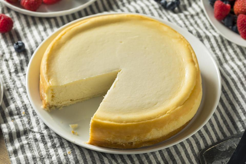 "<p>While cheesecake has ""cake"" in its name, it is definitely more of a pie with its custard-like cream cheese filling and graham cracker crumb pie crust. The dessert comes in many styles and flavors but perhaps the most famous is New York-style cheesecake. The unique style is dense, filled with cream cheese and served without fruit. <a href=""https://www.thedailymeal.com/recipes/new-york-style-vanilla-cheesecake-recipe?referrer=yahoo&category=beauty_food&include_utm=1&utm_medium=referral&utm_source=yahoo&utm_campaign=feed"" rel=""nofollow noopener"" target=""_blank"" data-ylk=""slk:Making this recipe at home"" class=""link rapid-noclick-resp"">Making this recipe at home</a> is a great way to celebrate the history of the Empire State and to really <a href=""https://www.thedailymeal.com/cook/genius-hacks-amateur-baker?referrer=yahoo&category=beauty_food&include_utm=1&utm_medium=referral&utm_source=yahoo&utm_campaign=feed"" rel=""nofollow noopener"" target=""_blank"" data-ylk=""slk:put your baking skills to the test"" class=""link rapid-noclick-resp"">put your baking skills to the test</a>.</p>"