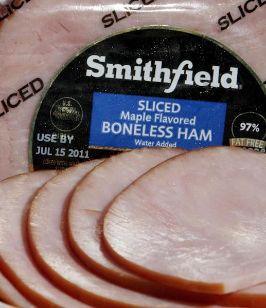 FILE - In this June 14, 2011 file photo, slices of a Smithfield boneless ham are displayed in Montpelier, Vt. One of Smithfield Foods Inc.'s largest shareholders, New York-based investment firm Starboard Value LP, said in a letter Monday, June 17, 2013, that a $4.72 billion takeover bid from China's largest meat producer falls short of what the company would be worth if sold off piece by piece. (AP Photo/Toby Talbot, File)