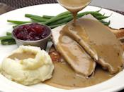 """<p>It's hard to say when, exactly, turkey gravy came into the picture, especially the homemade kind that is created from the drippings of a turkey. But we do know that packaged turkey gravy powder mixes got big in the 1950s, when, according to <em><a href=""""https://www.theatlantic.com/technology/archive/2010/11/its-all-gravy-the-industrial-history-of-a-thanksgiving-favorite/66915/"""" rel=""""nofollow noopener"""" target=""""_blank"""" data-ylk=""""slk:The Atlantic"""" class=""""link rapid-noclick-resp"""">The Atlantic</a>,</em> convenience in the kitchen became a huge deal. </p>"""