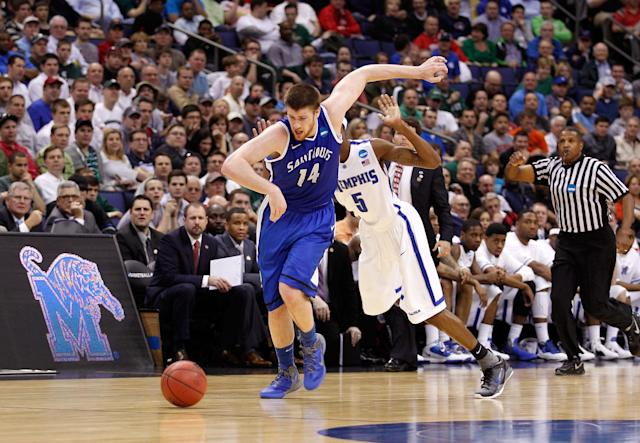 COLUMBUS, OH - MARCH 16: Brian Conklin #14 of the Saint Louis Billikensa nd Will Barton #5 of the Memphis Tigers go for a loose ball late in the second half during the second round of the 2012 NCAA Men's Basketball Tournament at Nationwide Arena on March 16, 2012 in Columbus, Ohio. (Photo by Rob Carr/Getty Images)