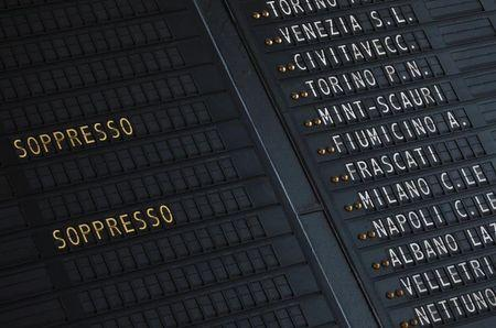 A timetable shows cancelled trains at Termini railway station in Rome