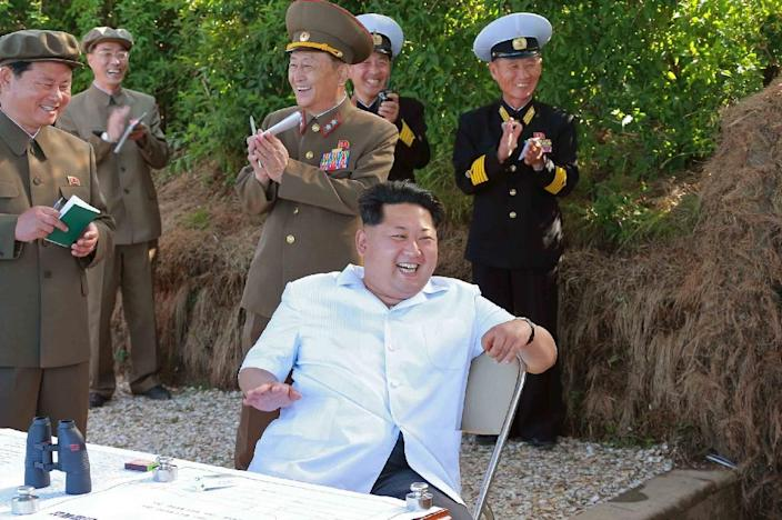 North Korean leader Kim Jong-Un (C) watches test firing of a new anti-ship rocket at an undisclosed location, in June 2015 (AFP Photo/-)