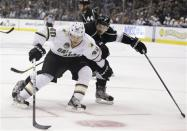 Dallas Stars' Ryan Garbutt, left, and Los Angeles Kings' Drew Doughty fight for the puck during the first period of an NHL hockey game in Los Angeles, Sunday, April 21, 2013. (AP Photo/Jae C. Hong)