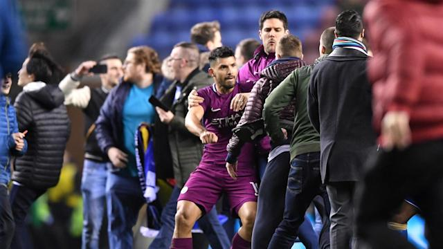 After supporters invaded the pitch following an FA Cup win against Manchester City, Wigan Athletic have been charged by the FA.