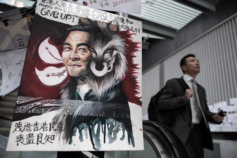 Artwork depicting Leung Chun-ying as a wolf, near the government headquarters in Hong Kong, October 10, 2014. The Hong Kong chief executive has reopened the offer of talks with students (AFP Photo/Philippe Lopez)
