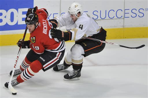Chicago Blackhawks' Bryan Bickell left, moves the puck against the Anaheim Ducks' Cam Fowler right, during the second period of an NHL hockey game in Chicago, Friday, March 29, 2013. Anaheim won 2-1. (AP Photo/Paul Beaty)