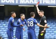 Chelsea's Thiago Silva is shown a red card by referee David Coote during the English Premier League soccer match between Chelsea and West Bromwich Albion at Stamford Bridge stadium in London, England, Saturday, April 3, 2021.(Clive Rose/Pool via AP)