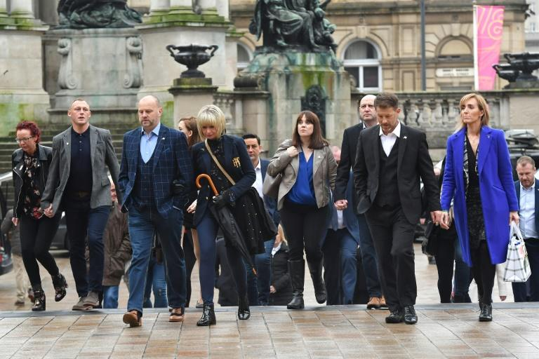 """Abuse victims of former football coach Barry Bennell outside  Liverpool Crown Court where he was jailed for 30 years with the judge calling him ~""""sheer evil"""""""