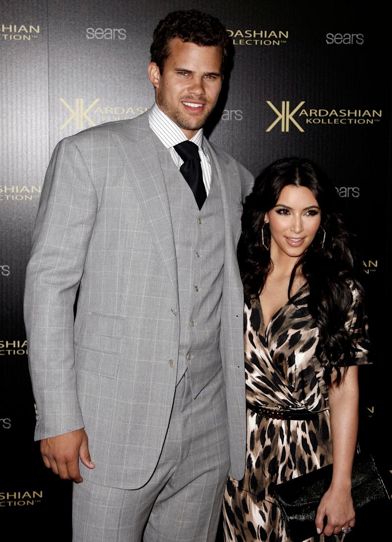 FILE - In this Aug. 17, 2011 file photo, Kim Kardashian, right, and her then fiance, NBA basketball player Kris Humphries, arrive at the Kardashian Kollection launch party in Los Angeles. A Los Angeles Superior Court Judge finalized Kardashian and Humphries' divorce on Monday, June 3, 2013, roughly six weeks after the reality star and NBA player reached a settlement in their long-running divorce case. Humphries had been seeking an annulment of couple's marriage, but agreed to a divorce before a trial on the matter. He claimed the couple's lavish, televised wedding was based on fraud, but never detailed his allegations in court. (AP Photo/Matt Sayles, File)
