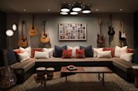 """<p>If you or your kids like to rock out, and you'd rather not disturb your neighbors, a basement is the perfect place to house a music room. <a href=""""https://kendallwilkinson.com/"""" rel=""""nofollow noopener"""" target=""""_blank"""" data-ylk=""""slk:Kendall Wilkinson Design"""" class=""""link rapid-noclick-resp"""">Kendall Wilkinson Design</a> created this stylish and comfy stunner, installing soundproofing on the walls and the ceiling.</p>"""